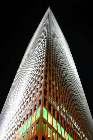 azrieli tower: Tel Aviv skyscraper, dark sky, some lighted windows  Stock Photo