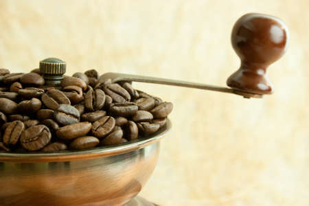 Coffee grinder with coffee beans photo