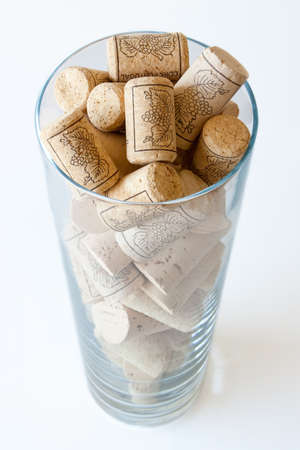 wine and dine: Wine cork in a glass on white background Stock Photo