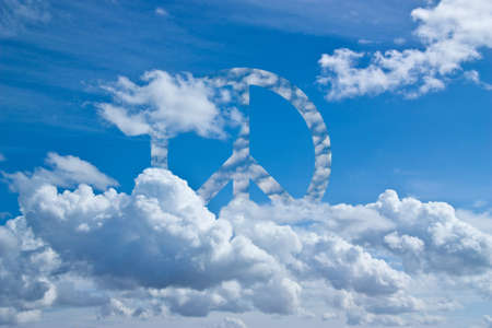 Blue sky with symbol of peace in the clouds Stock Photo