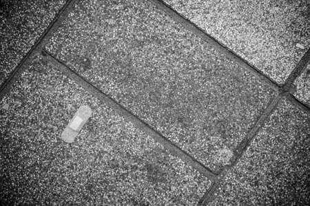 bandaid: Band-Aid on Pavement