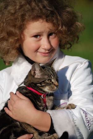 The girl holds on hands of a cat Stock Photo - 4339092