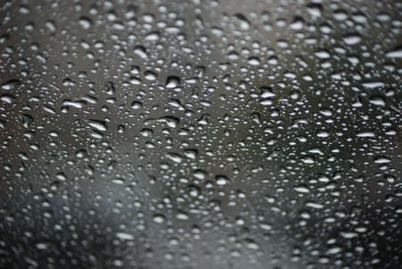 Rain drops on glass close up nice background concept photo