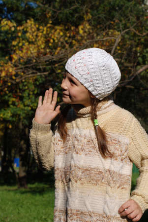 Portrait of little girl in the white stocking little cap Stock Photo - 4351565
