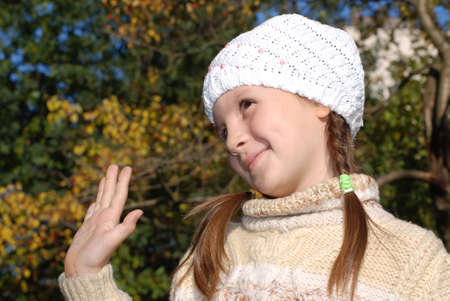 Portrait of little girl in the white stocking little cap Stock Photo - 4351553