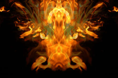 Abstract hot fire peacock feather on dark background photo