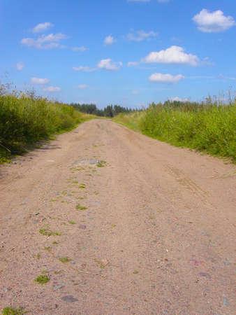 Soil road through a field Stock Photo - 4392545