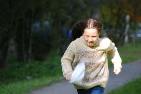 Quickly runing little girl, to go in for sports Stock Photo - 4392548