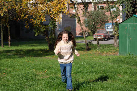Quickly runing little girl, to go in for sports Stock Photo - 4392528