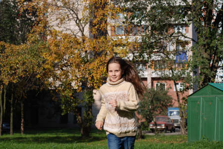 Quickly runing little girl, to go in for sports Stock Photo - 4392523