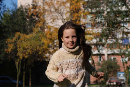 Quickly runing little girl, to go in for sports Stock Photo - 4392546