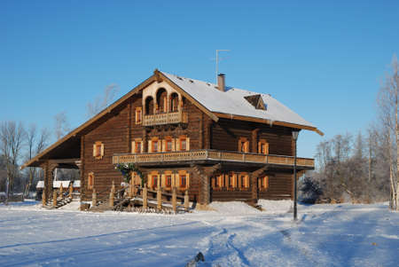 Traditional farmhouse of the north russian  village photo