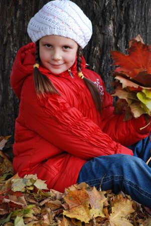 little girl near a tree in an autumn park Stock Photo - 4780975