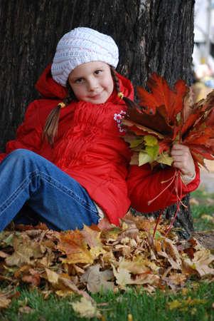 little girl near a tree in an autumn park Stock Photo - 4780977