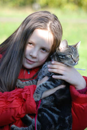 The girl holds on hands of a cat photo
