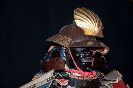 Historic samurai armor on black photo