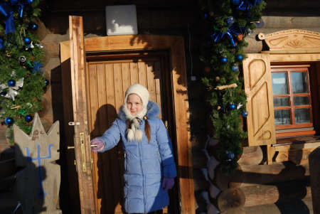 threshold: little girl on the threshold of wooden house in the Russian country