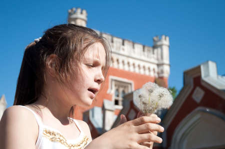 swelled: little girl with dandelions Stock Photo