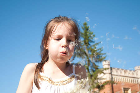 drenched: little girl with dandelions Stock Photo