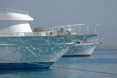 motor launch: Docked boat in sea port, read sea