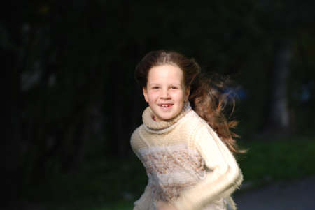 blown about long hairs: girl with blown  about from wind hairs Stock Photo