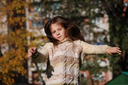 wind blown hair: girl with blown  about from wind hairs Stock Photo