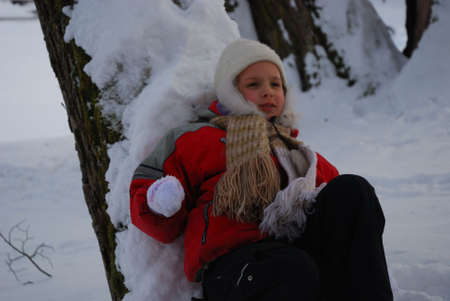 a little girl is in a winter park photo