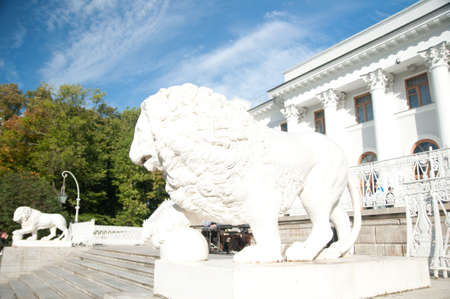 attribute: white statue of lion on a background a white palace, Sankt - Petersburg, Russia