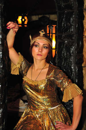 The woman in a crown and a gold dress photo