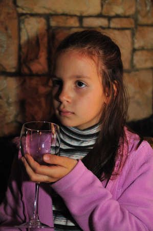 suppertime: The girl with a glass in a hand Stock Photo