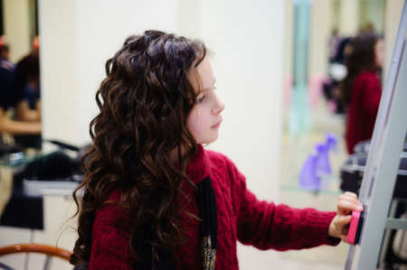The little girl with a long curly hair photo