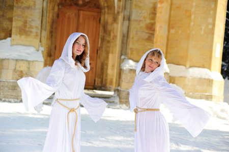 Two girls in suits of angels
