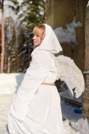 Blonde girl with long hair and angels wings photo