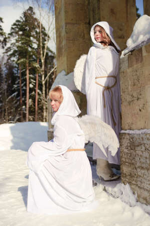 Two girls in suits of angels Stock Photo - 6631608