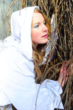 Blond beautiful girl wearing white fleece hood Stock Photo - 6631622