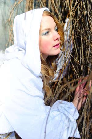 Blond beautiful girl wearing white fleece hood Stock Photo - 6631622