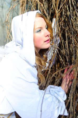 Blond beautiful girl wearing white fleece hood Stock Photo - 6631611