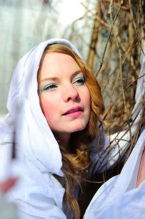 Blond beautiful girl wearing white fleece hood Stock Photo - 6631602