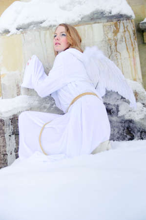 cassock: The young girl in a white attire with wings of an angel