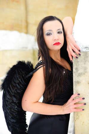 angel alone: Dark angel Stock Photo