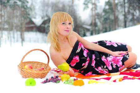 Beautiful girl on picnic with fruts photo