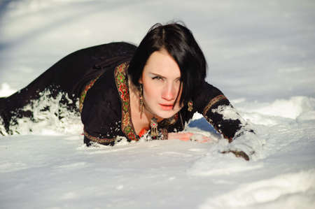 Picture of a girl who lies on the snow photo