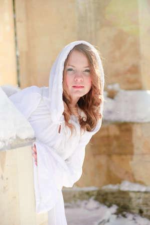 cassock: Blond beautiful girl wearing white fleece hood
