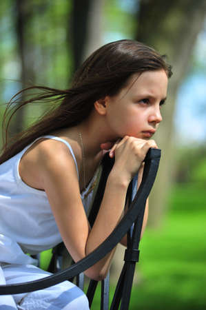 Portrait of the little girl with long hair looking aside Stock Photo - 7077503