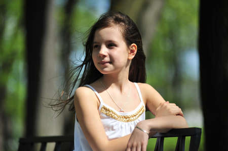 Portrait of the little girl with long hair looking aside Stock Photo - 7077505