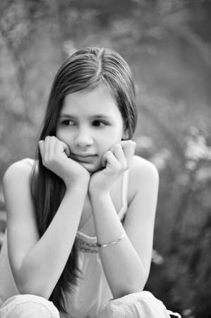Portrait of the little girl with long hair looking aside Stock Photo - 7077504