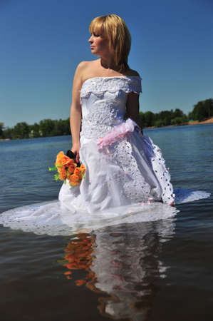 portrait of bride dressed in wedding gown in water Stock Photo - 7104995