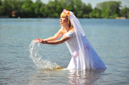 portrait of bride dressed in wedding gown in water Stock Photo - 7101008
