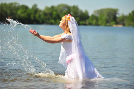 portrait of bride dressed in wedding gown in water Stock Photo - 7105018