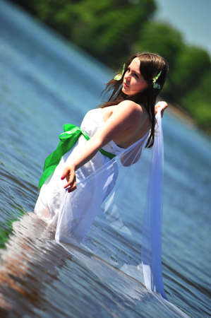 The girl in a white dress in water photo